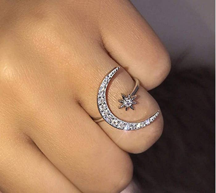 Hand with a moon and star ring on the ring finger