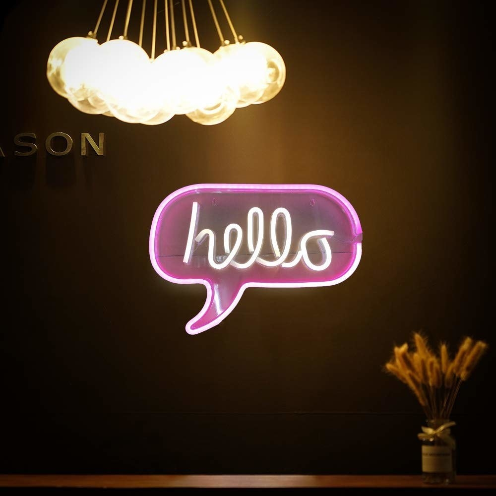 A new sign with a purple speech bubble and white text that says 'Hello'