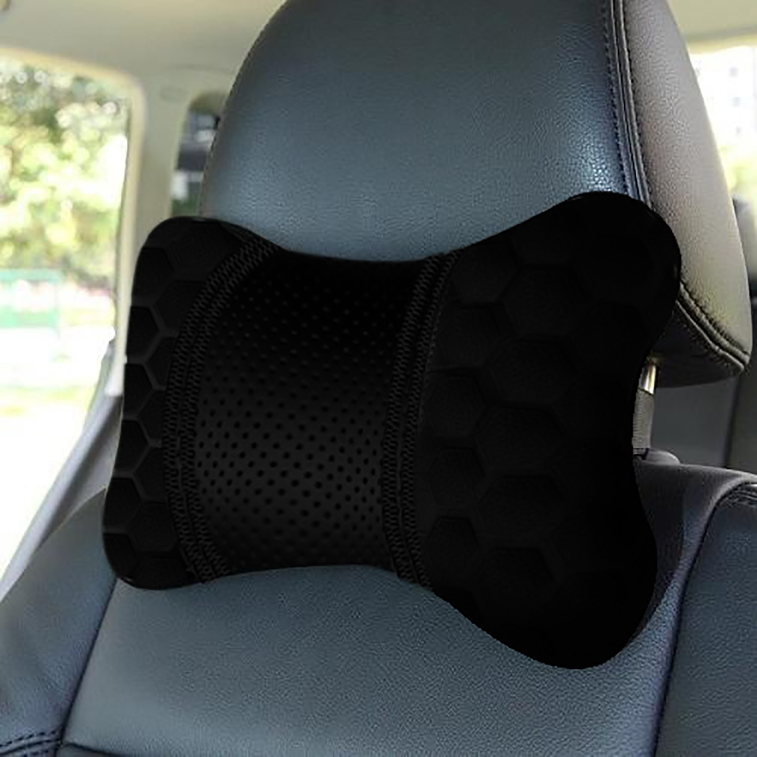 A neck pillow on the front seat of the car.
