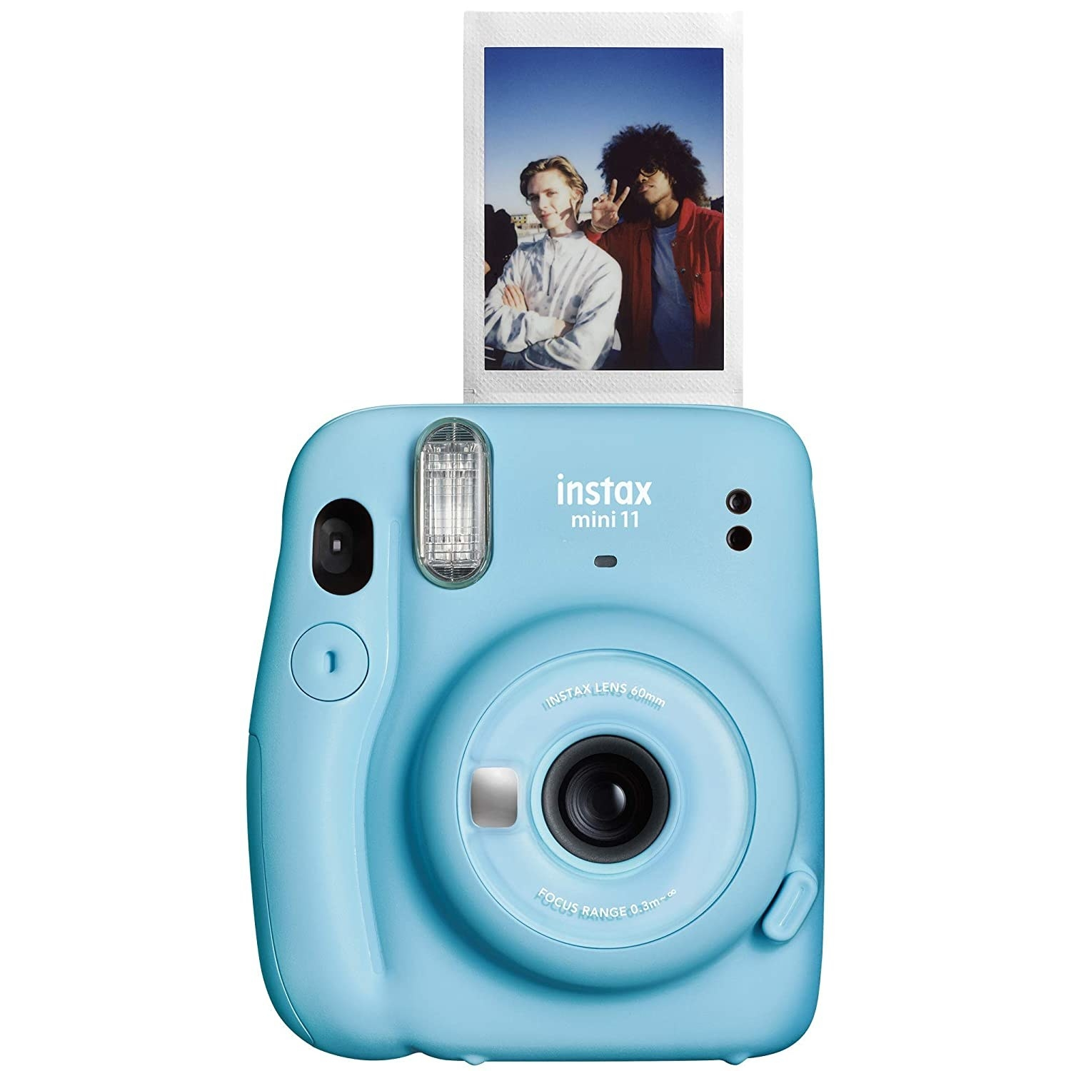 An ice blue polaroid camera with a polaroid photo coming out its top.