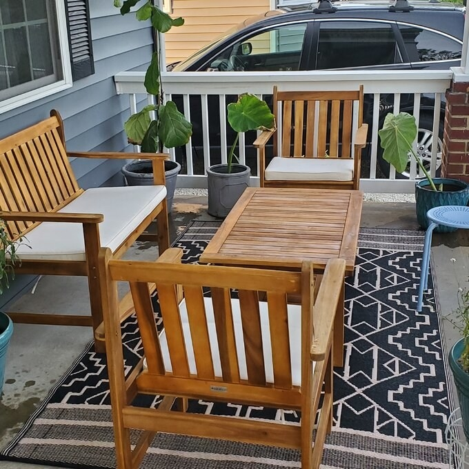 reviewer photo of the wooden set with white chair cushions