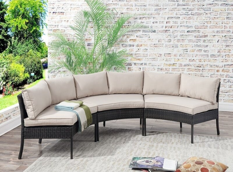 the patio sectional with cream colored cushions