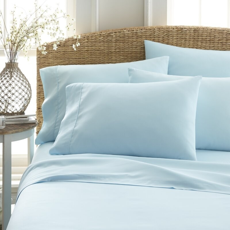 the light blue bed sheets