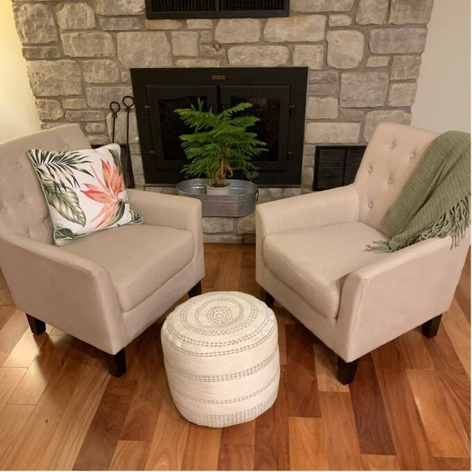 reviewer photo of two of the tufted chairs in oatmeal color