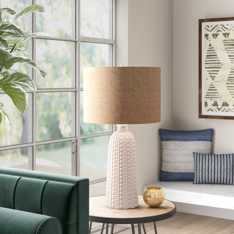 the cream lamp on a side table