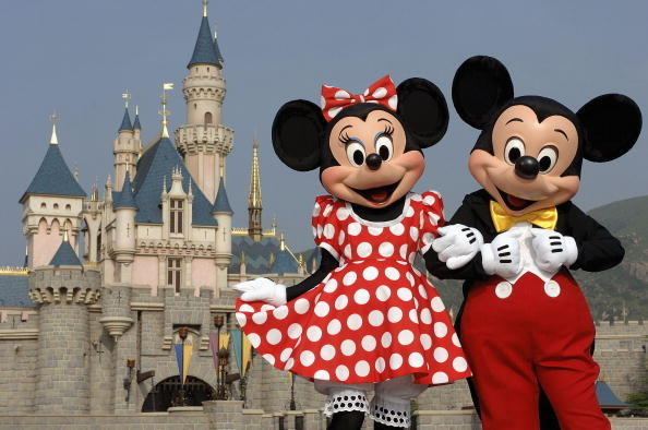 Minnie and Mickey Mouse arm-in-arm
