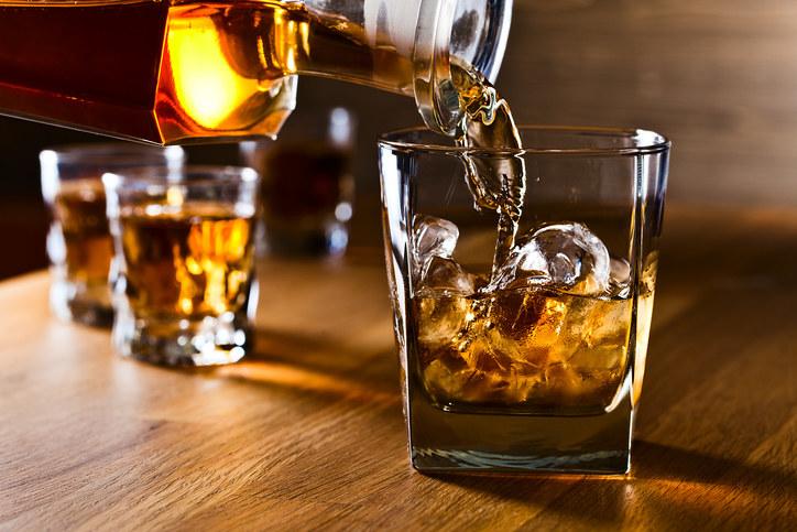 Liquor being poured into a glass