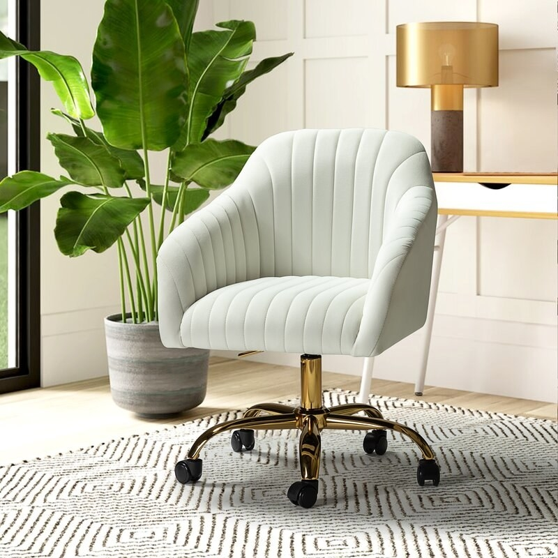 the task chair in white next to a plant