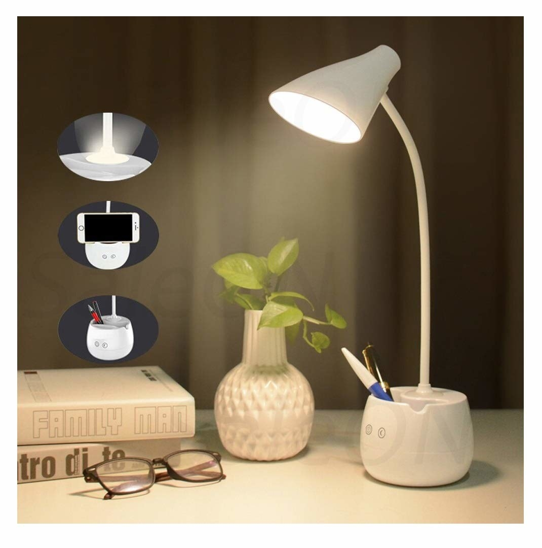 A picture of a desk with white lamp