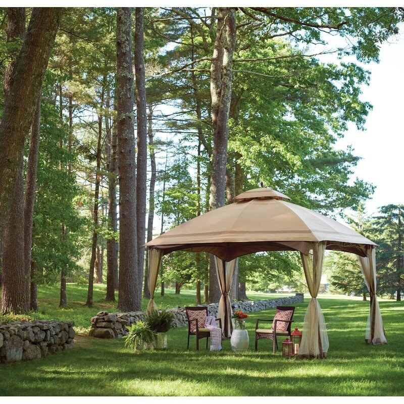the patio gazebo on a lawn with two chairs underneath it