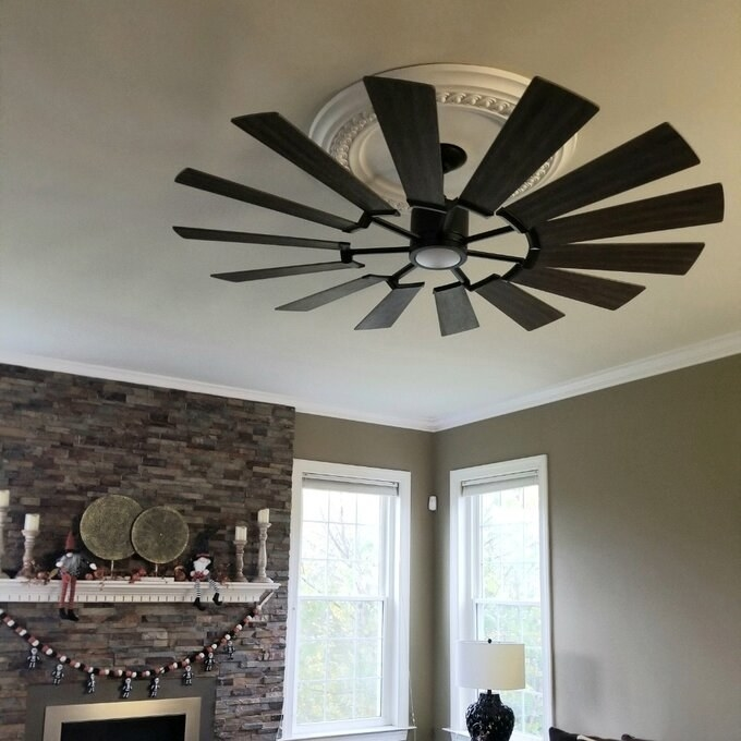reviewer photo of the ceiling fan with center light hanging on the ceiling