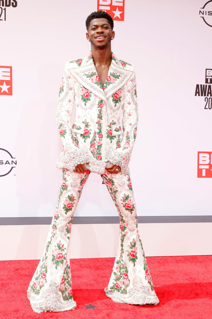 Lil Nas X attends the BET Awards 2021 in a floral print suit with wide legs