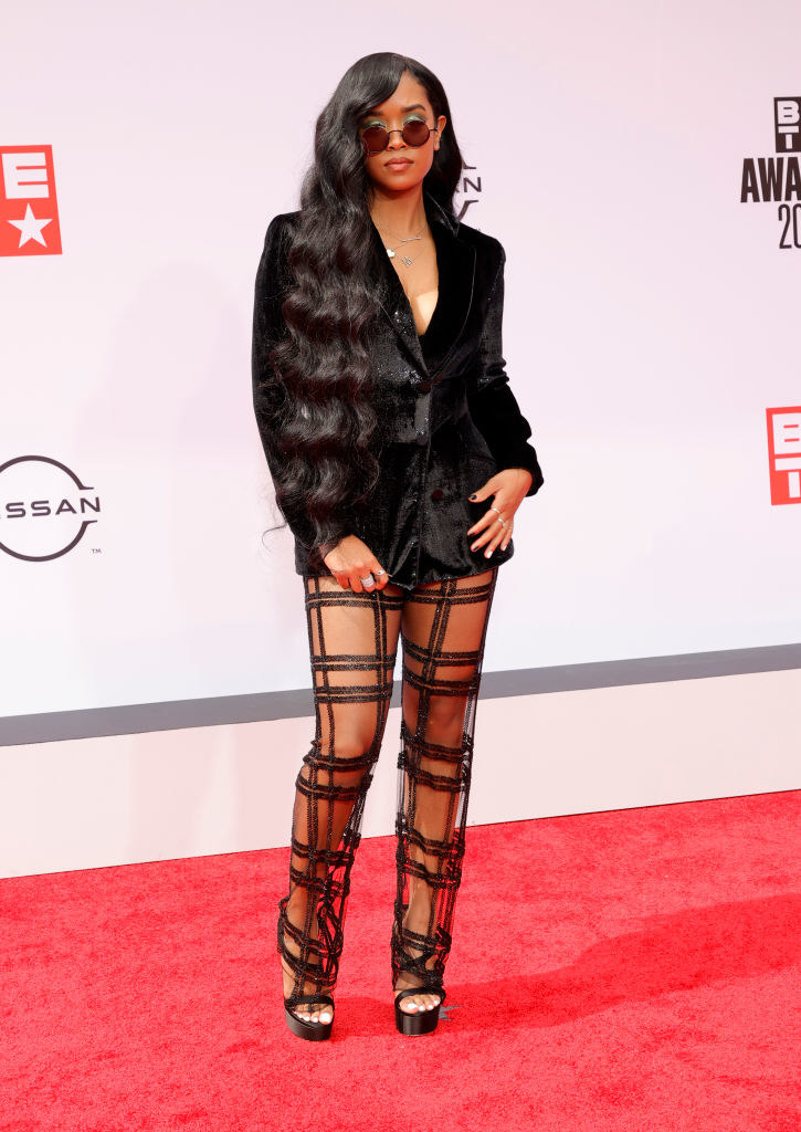 H.E.R. attends the BET Awards 2021 in a suit with see-through pants