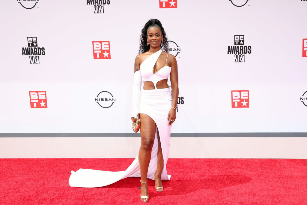 Ari Lennox attends the BET Awards 2021 in a gown featuring cutouts