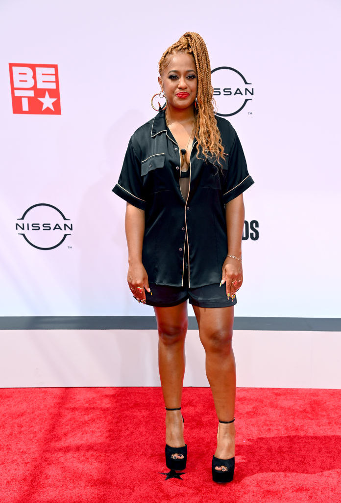 Rapsody attends the BET Awards 2021 in a satin pajama-inspired outfit and heels