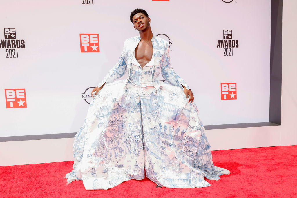 Lil Nas X attends the BET Awards 2021 in a patterned, voluminous outfit with a jacket top