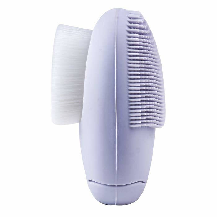 This purple facial massager has silicone brush on one side and a soft sponge on the other.