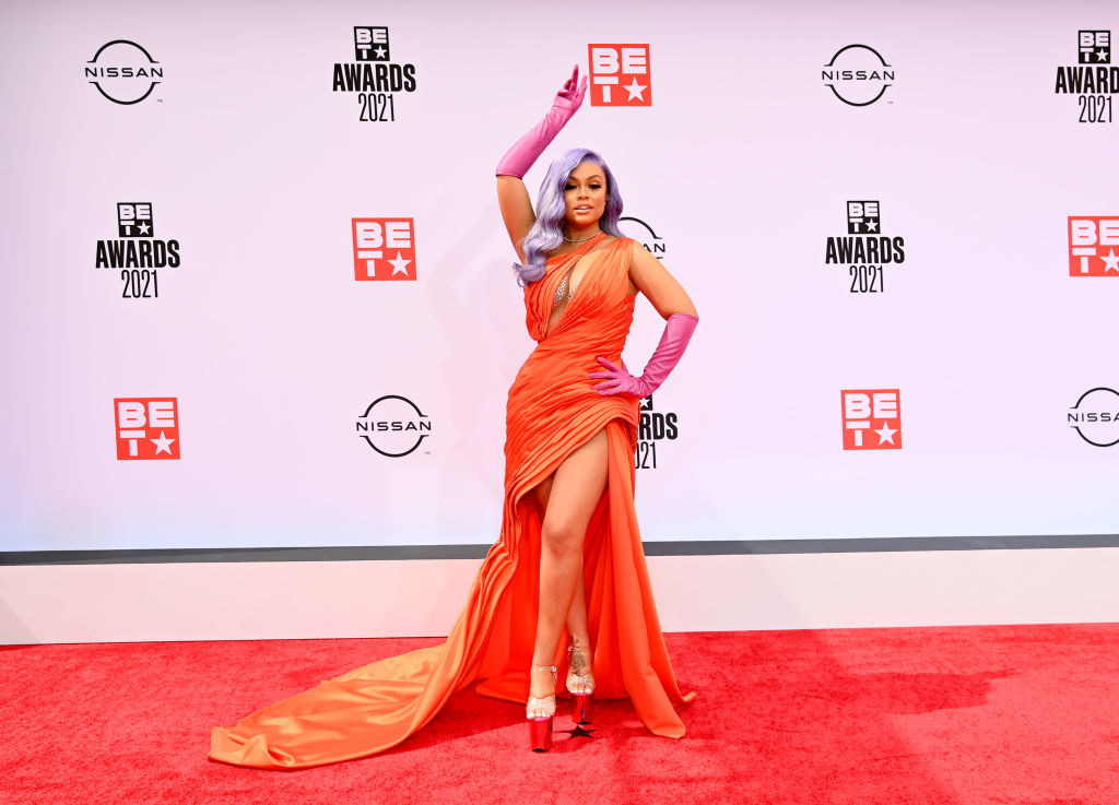 Latto attends the BET Awards 2021 in a one-shoulder gown and gloves