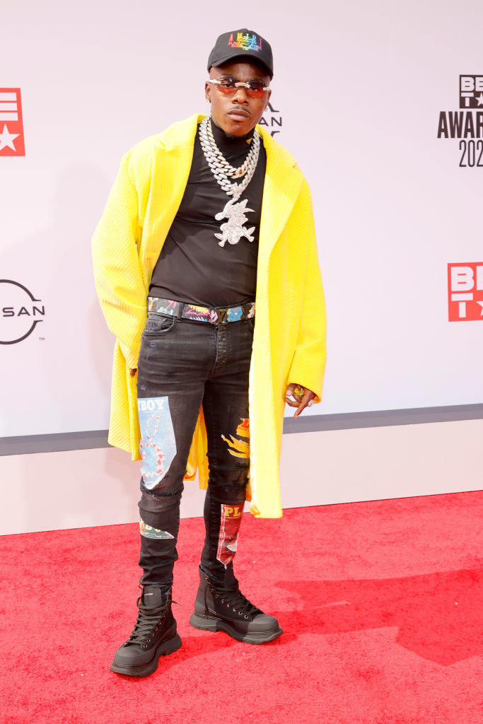 DaBaby attends the BET Awards 2021 in a long coat, jeans, and combat boots