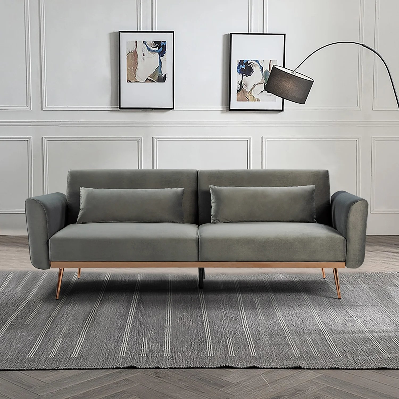 The long, gray velvet sofa with rose gold legs in a living room