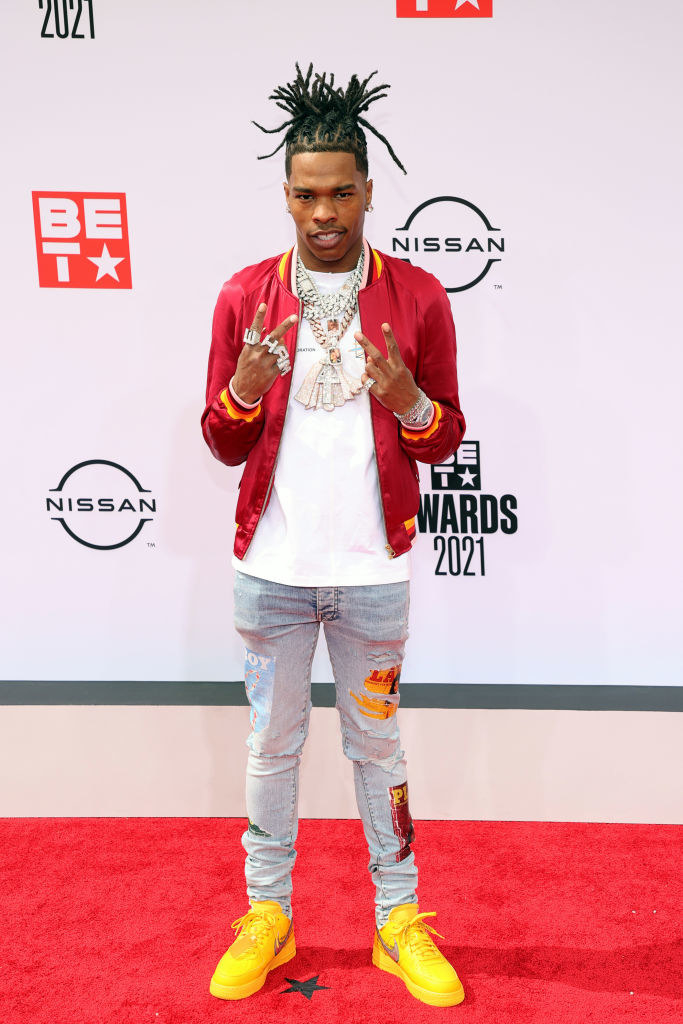 Lil Baby attends the BET Awards 2021 in a tee, jeans, and satin jacket
