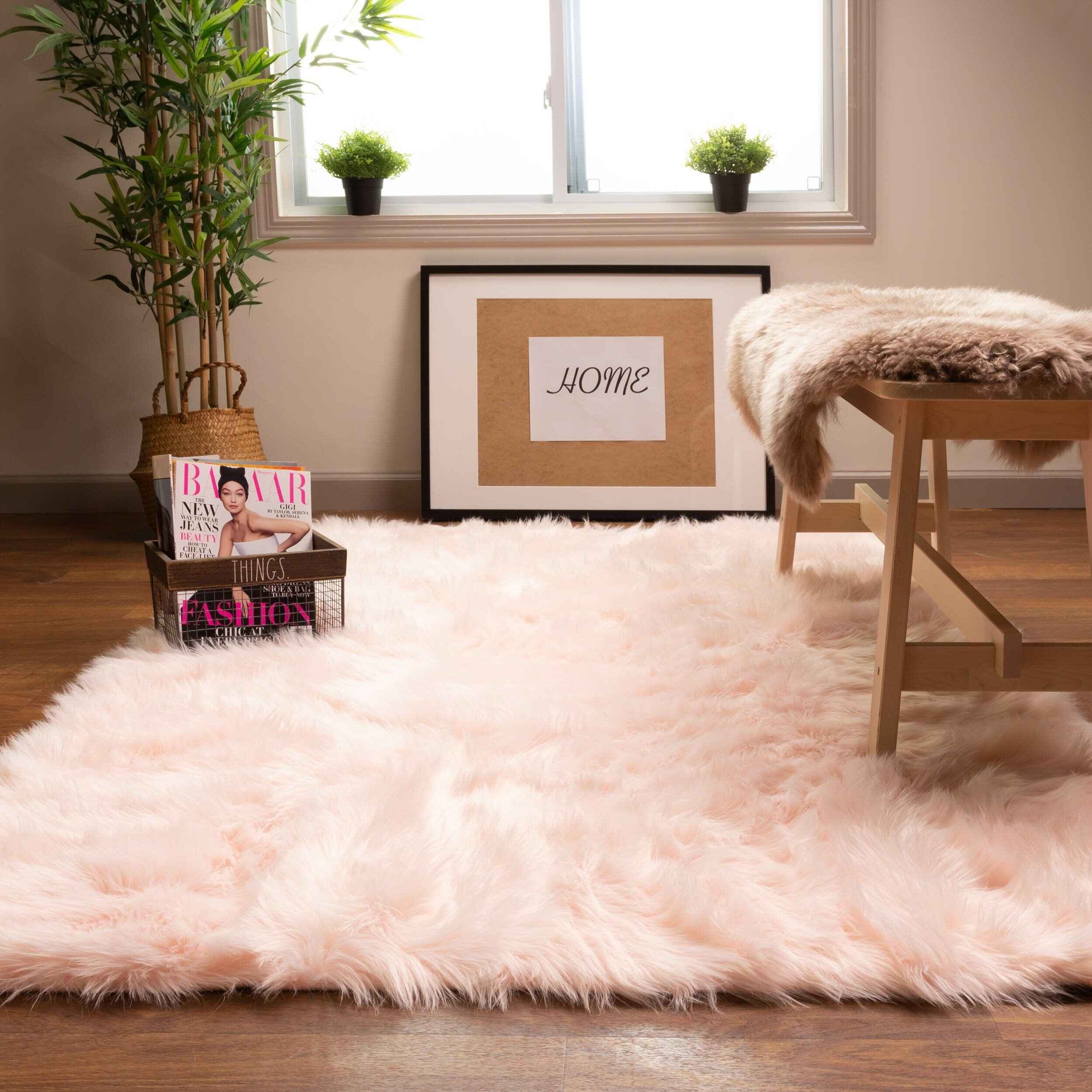 the rug in pink on a living room floor
