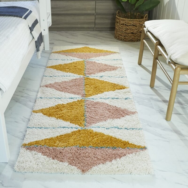 the rug in off-white, mustard and pink
