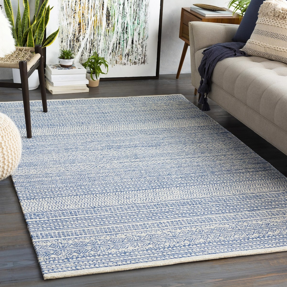 The blue and cream area rug with a geometric pattern in a living room