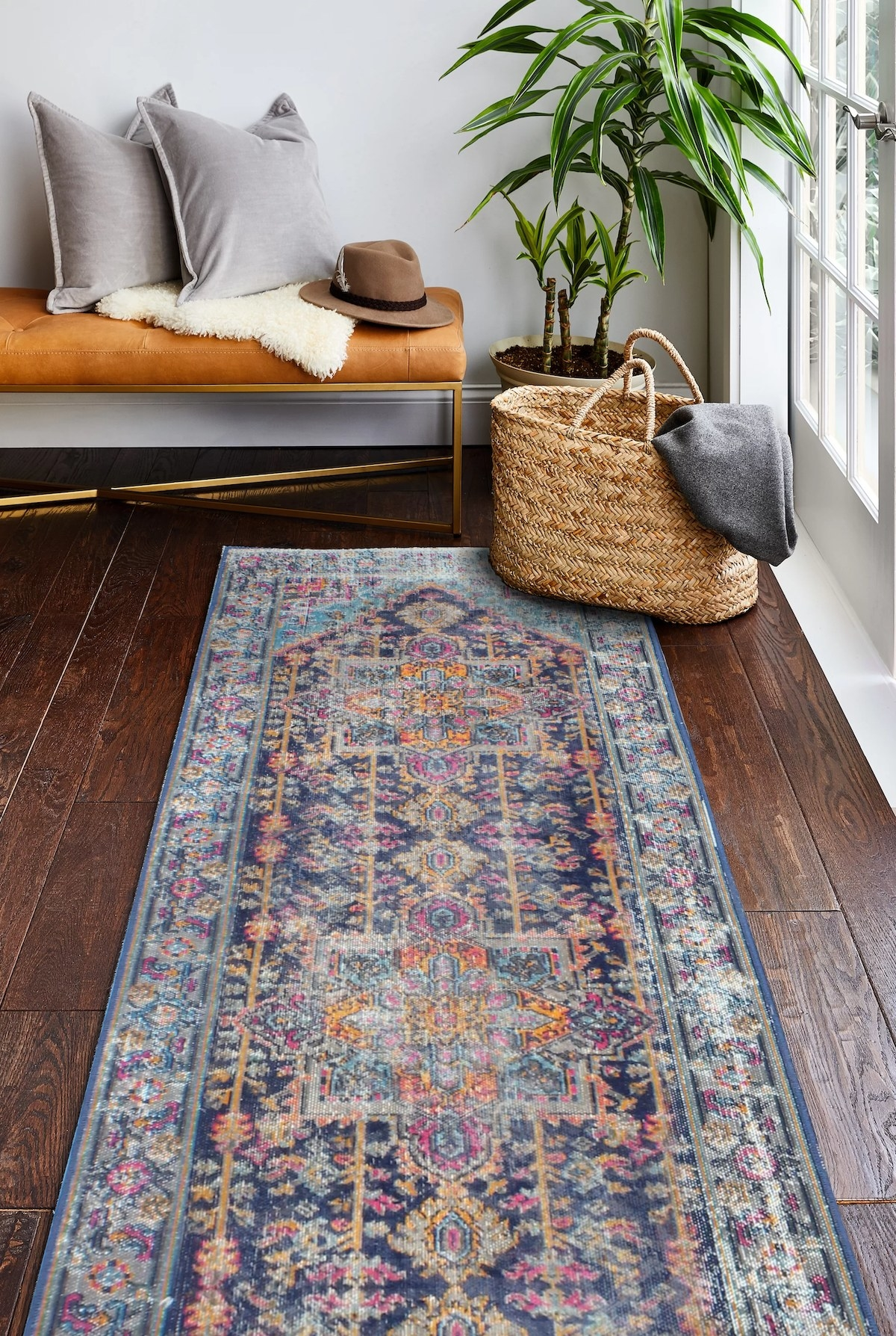 The blue, pink and beige runner in an entryway