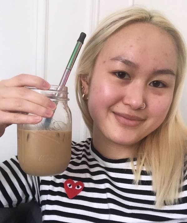 buzzfeed editor holding a glass of iced coffee