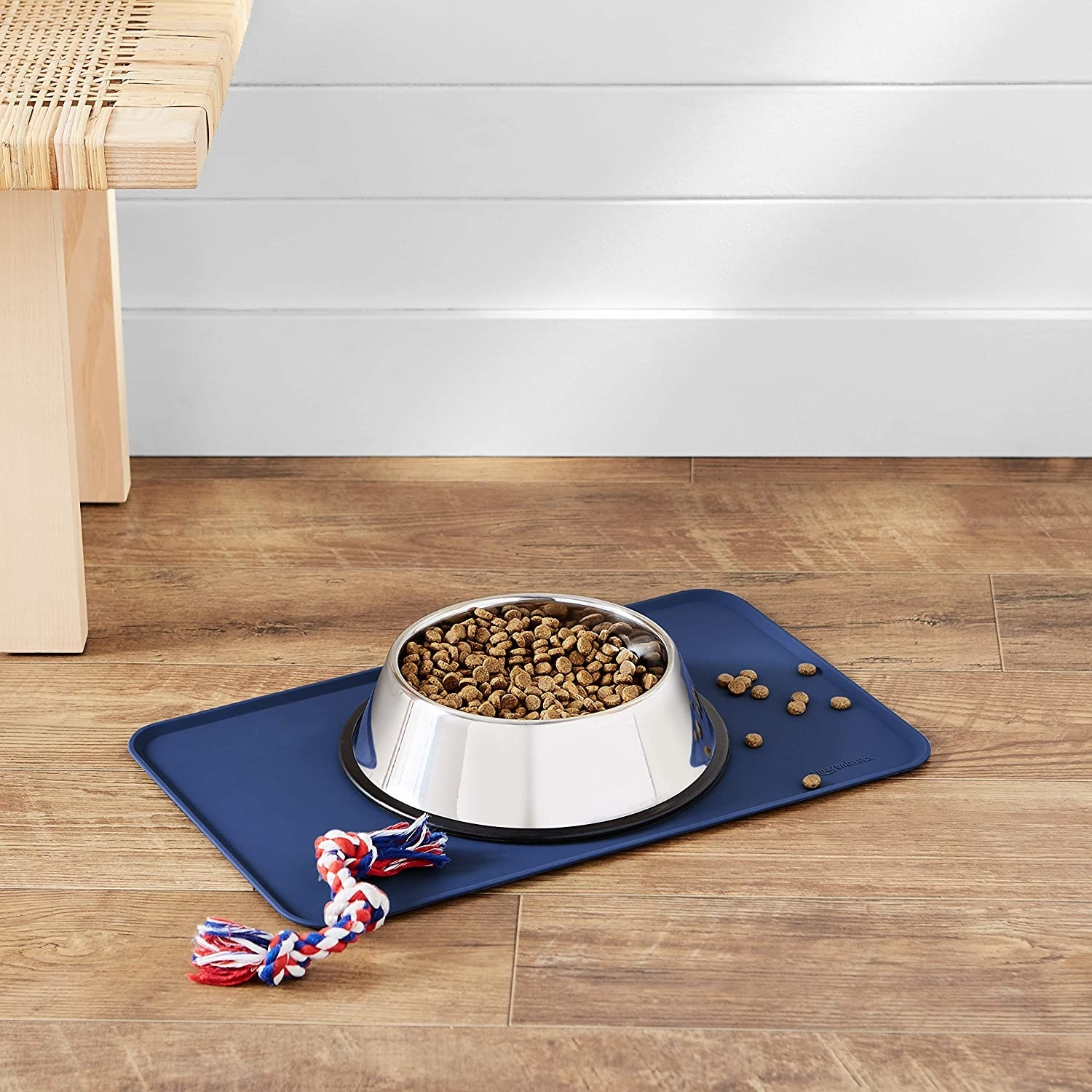A dog bowl with food kept on a silicone mat.