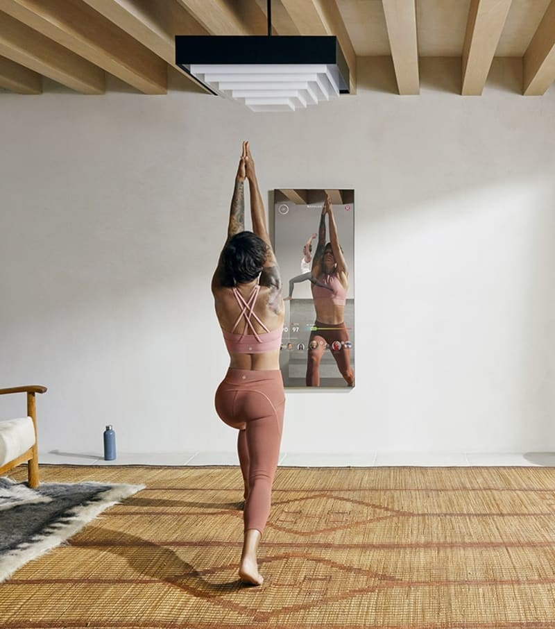 a model does yoga in front of the mirror