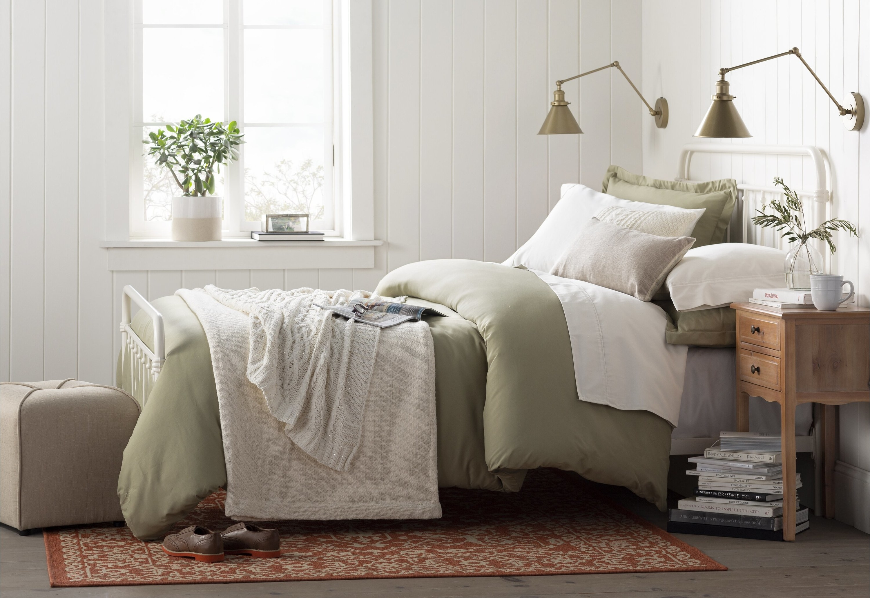 the sheet set in green on a bed