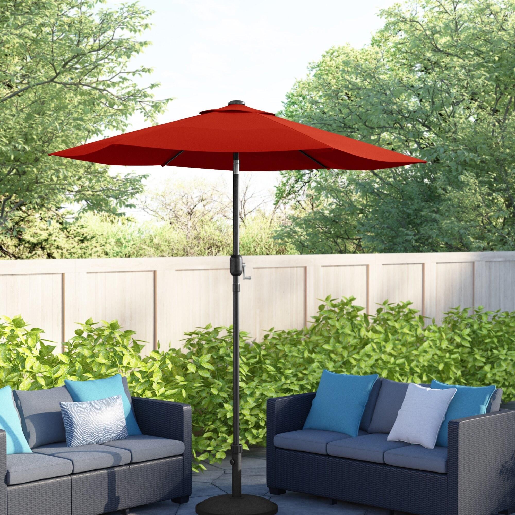 the umbrella in orange in a backyard