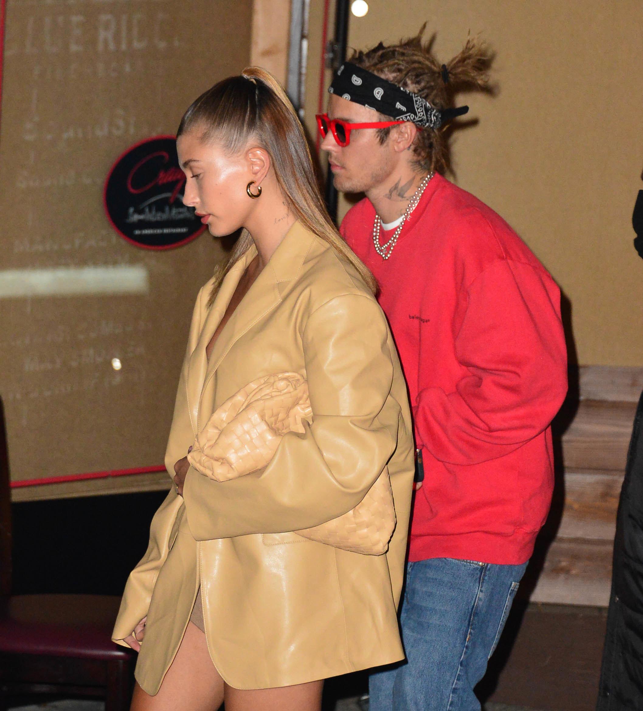 Hailey and Justin walking and not looking at the camera