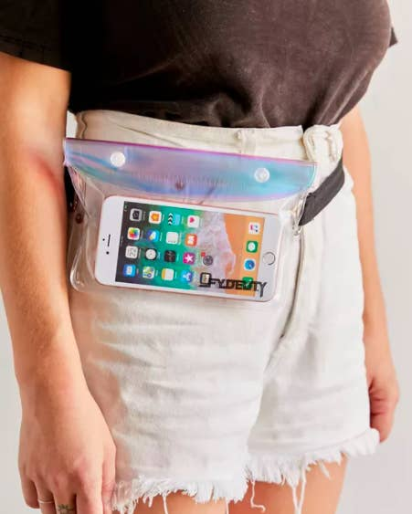 A person wearing a transparent belt bag with their phone inside