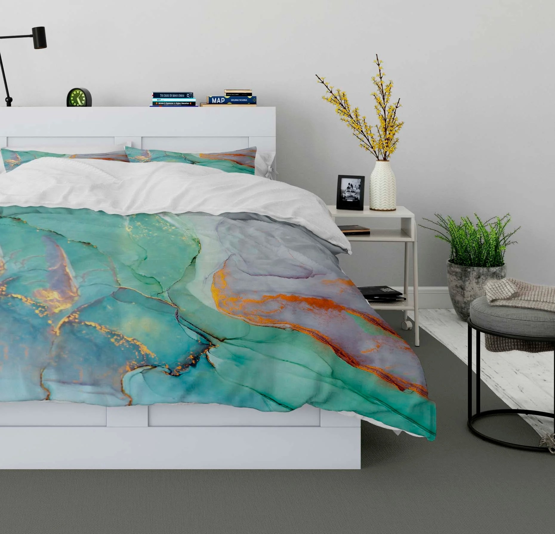 The blue and green duvet with a watercolor-like pattern on a queen bed