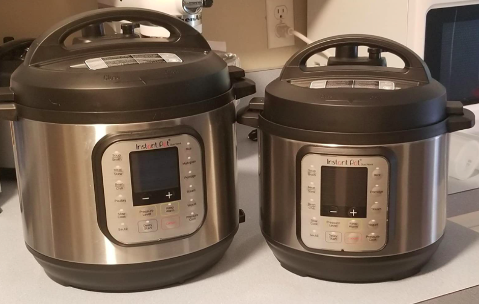 A customer review photo of two Instant Pots in two sizes sitting on their counter