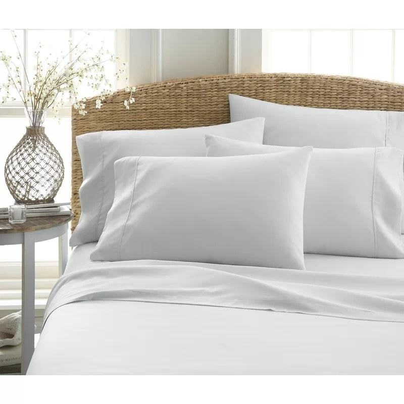 The light gray sheet set on a queen bed