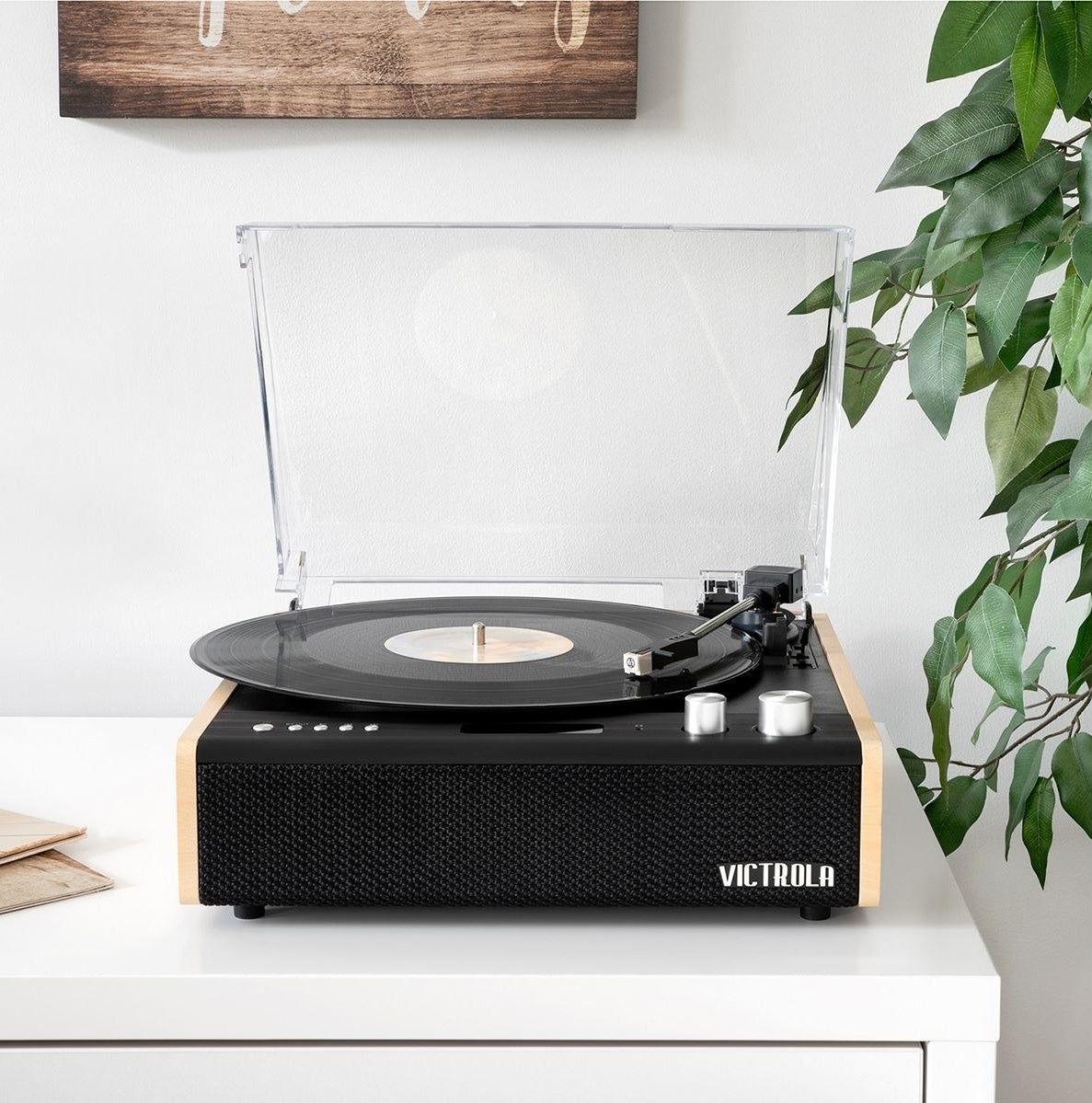 the Victrola eastwood record player open, with a record in it