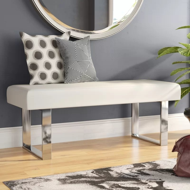 The rectangular bench with chrome legs in an entryway