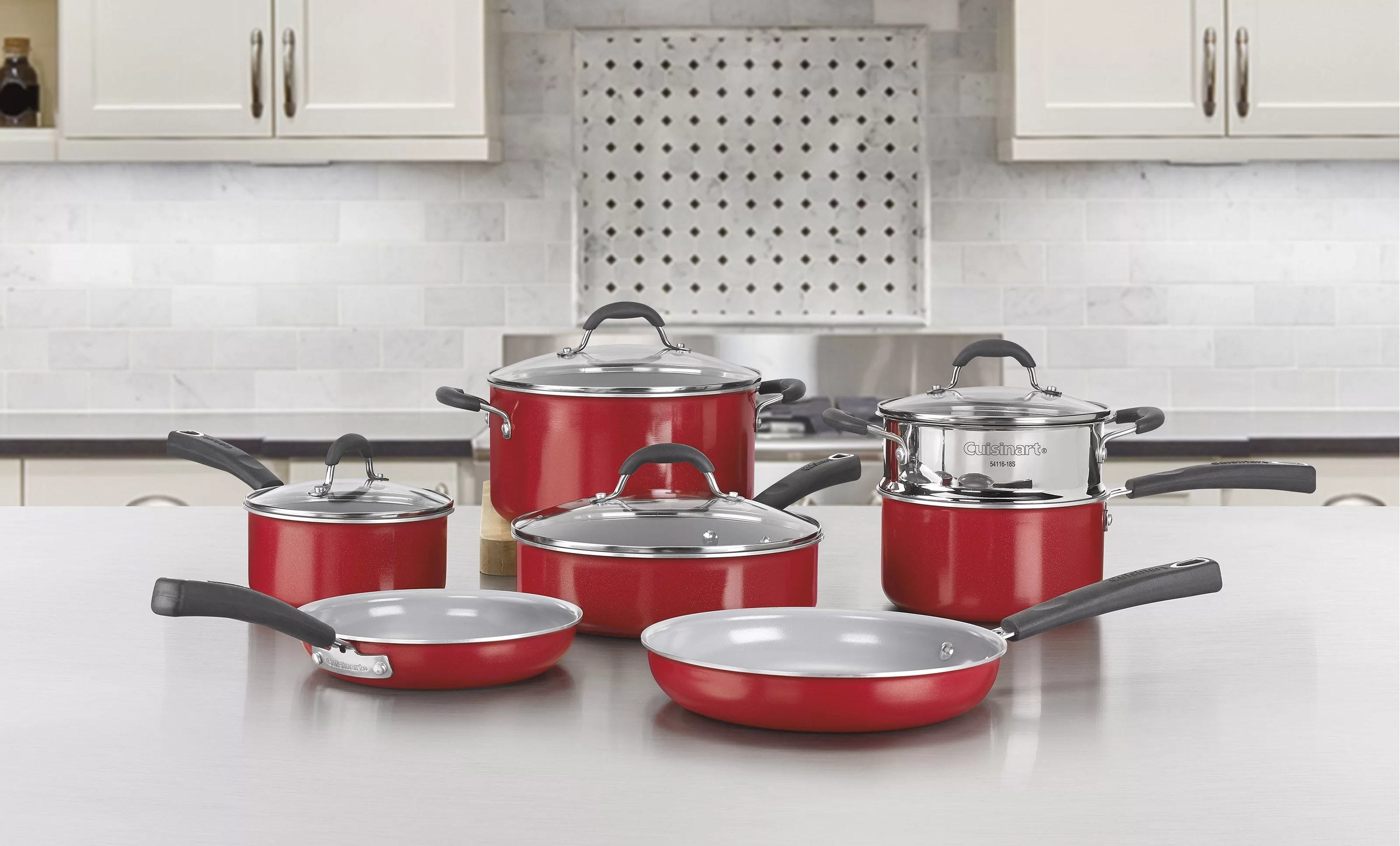 The 11-piece red and gray set on a kitchen counter