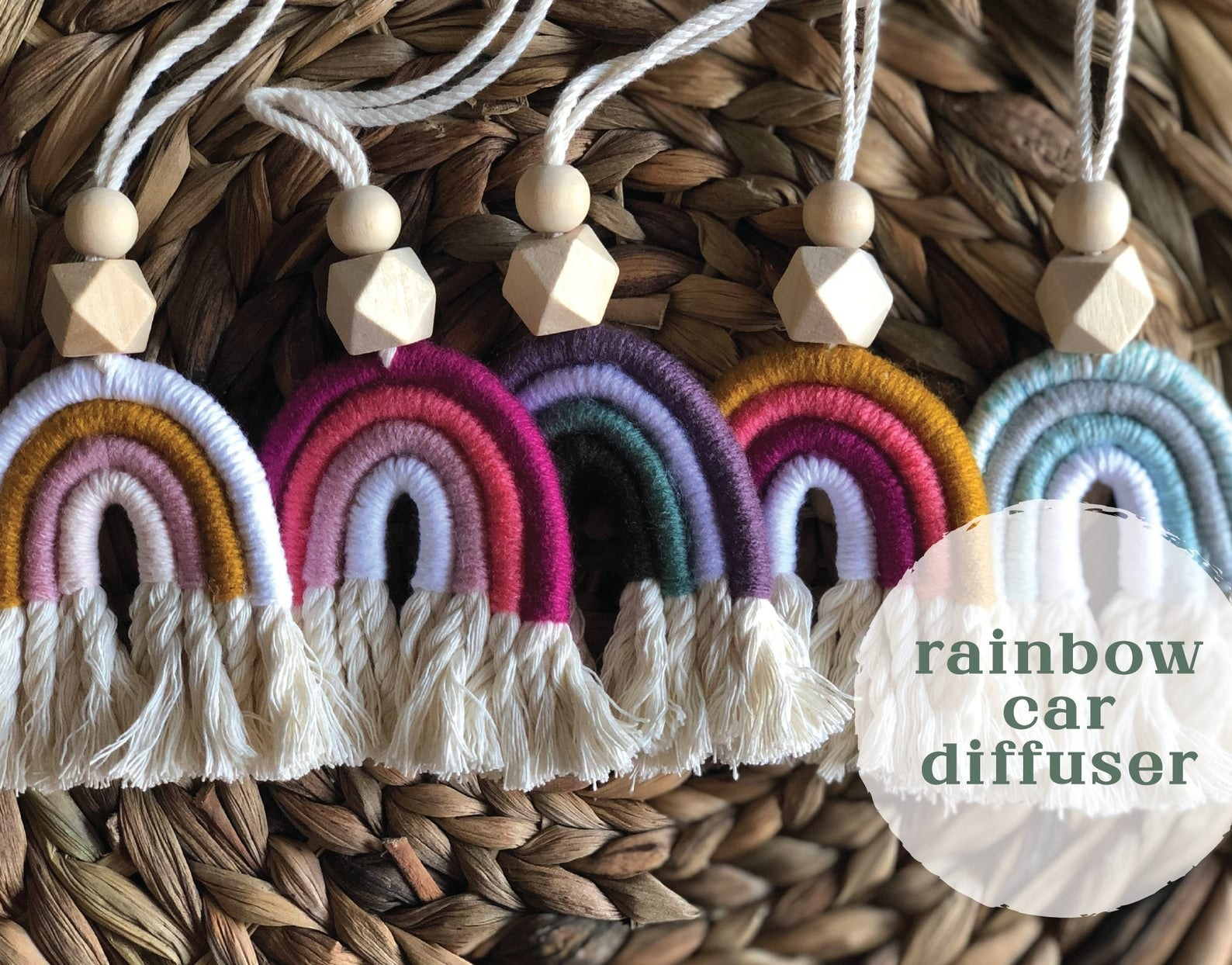 Five rainbow car diffusers in various colors