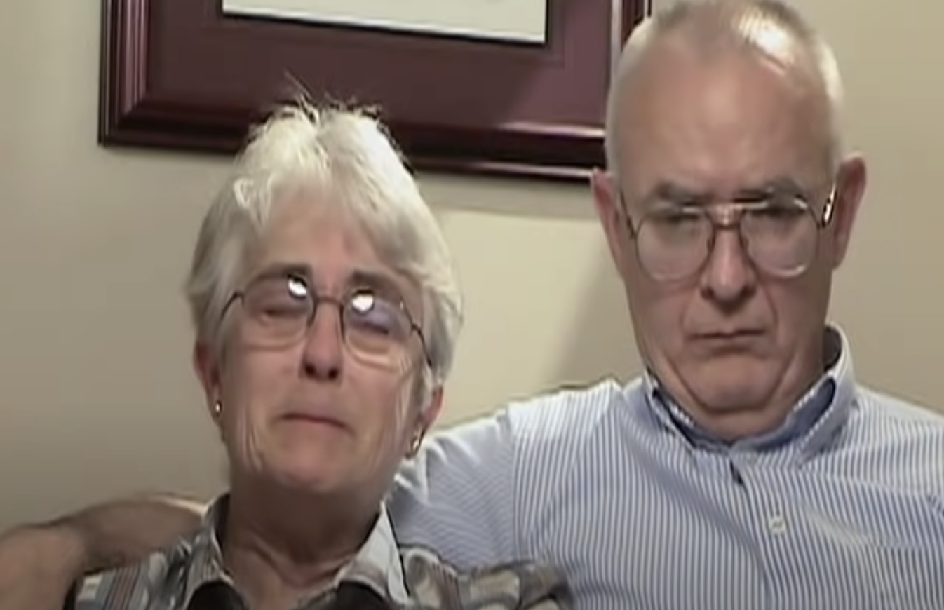 The parents of the murdered man crying while giving a testimonial to the camera
