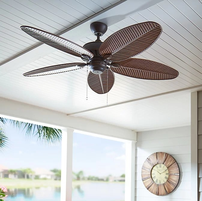 The brown fan hanging from a porch ceiling