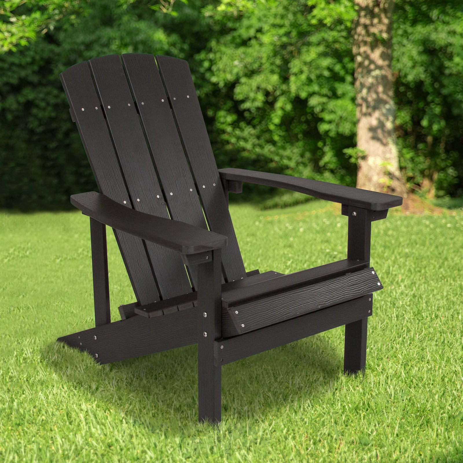 The black chair with a slanted back and arms on either side