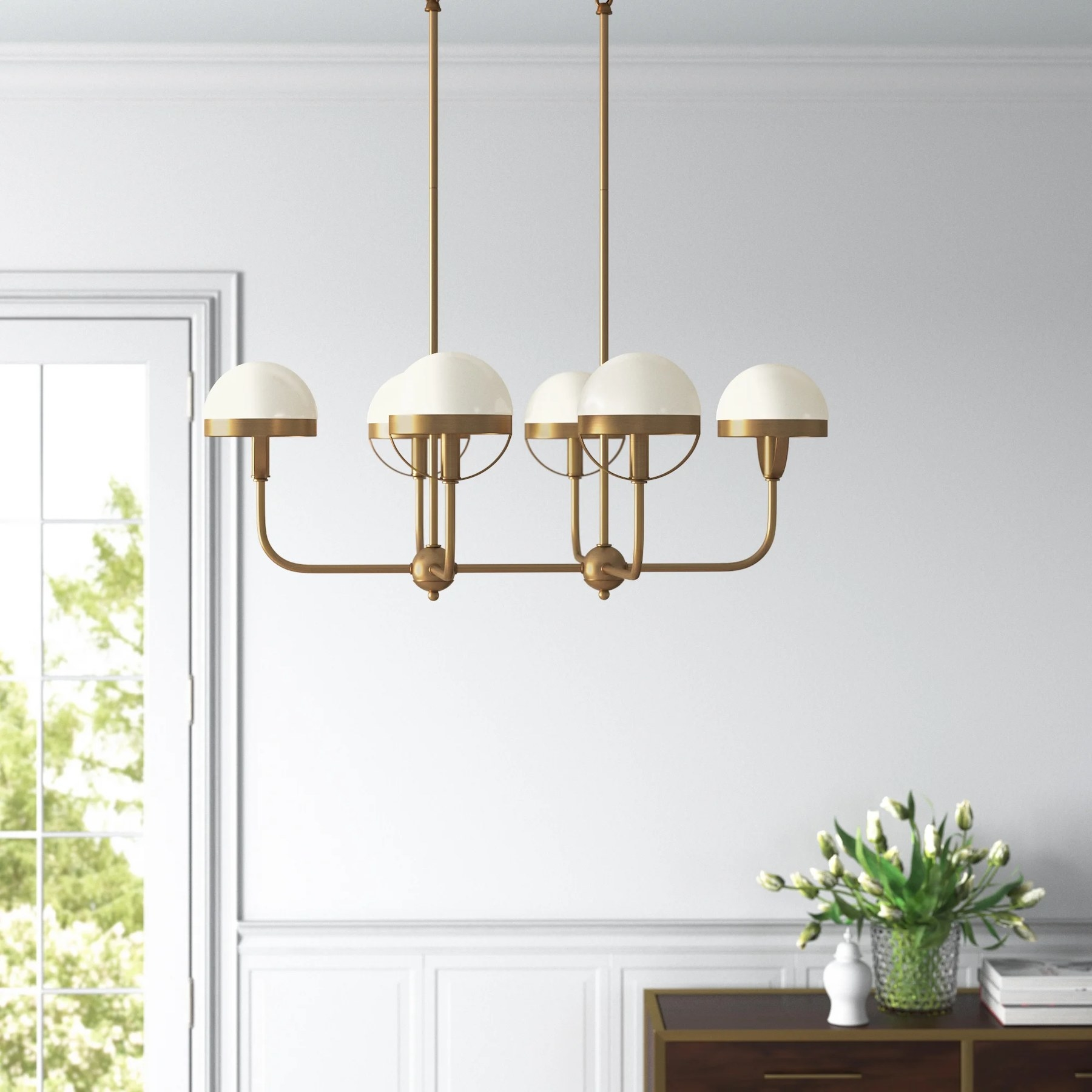The pendant with six individual circular lights hanging in a living room