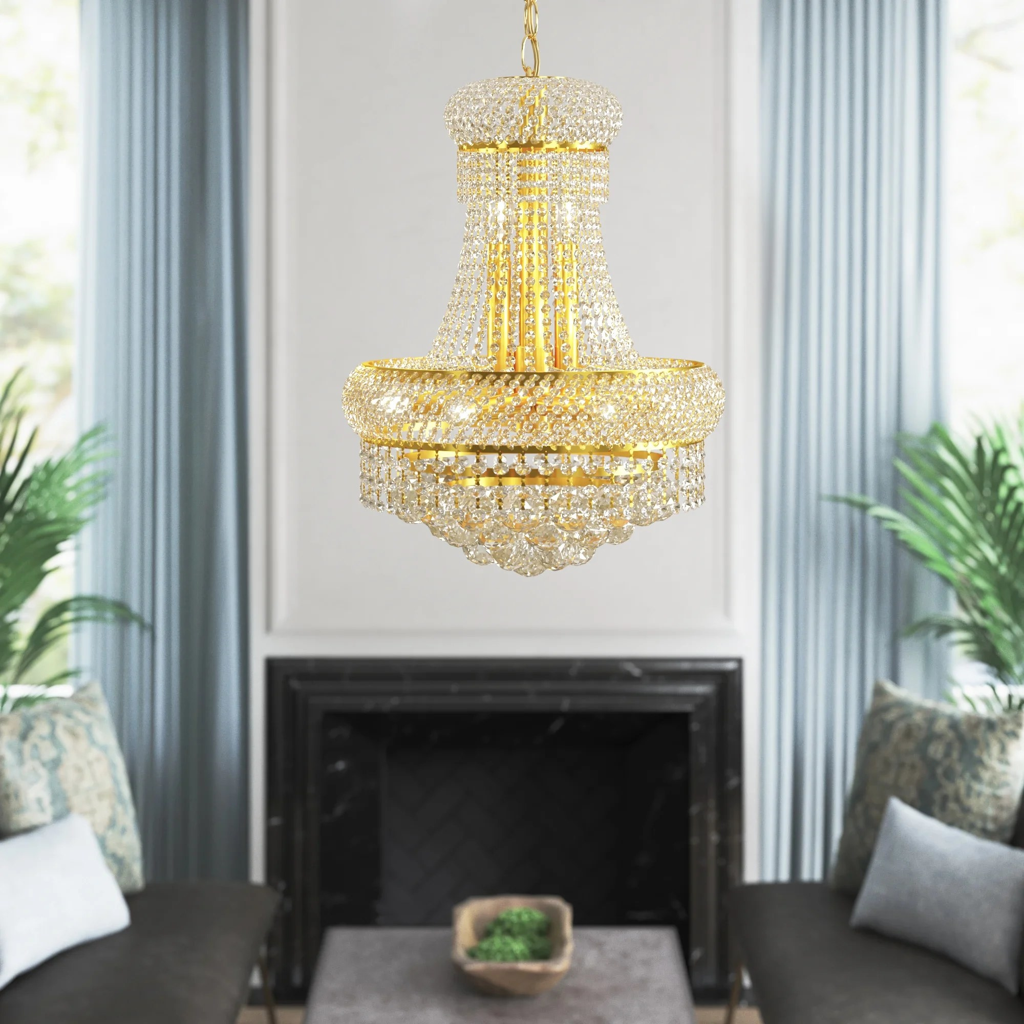 The gold chandelier with gradually cascading crystals hanging from the ceiling in a living room
