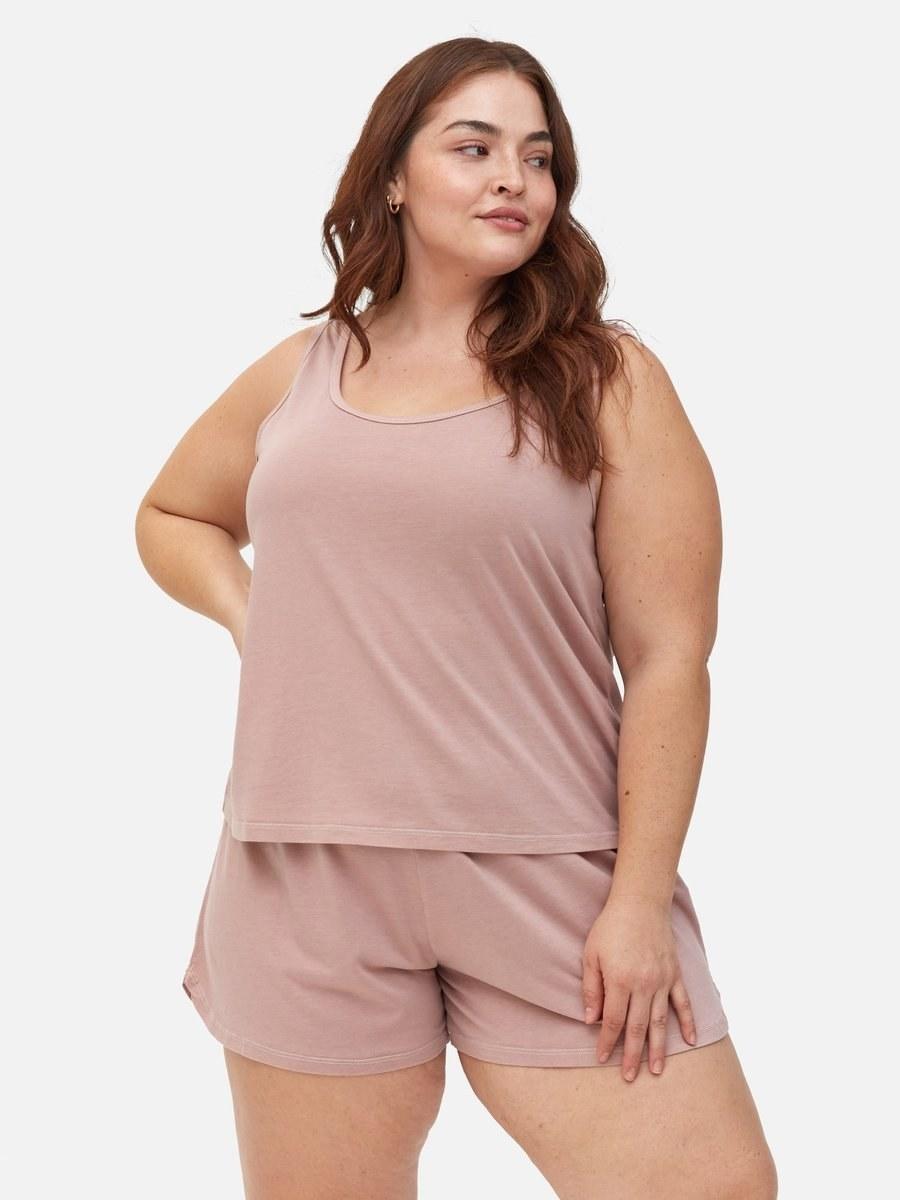 model wearing a pink tank top