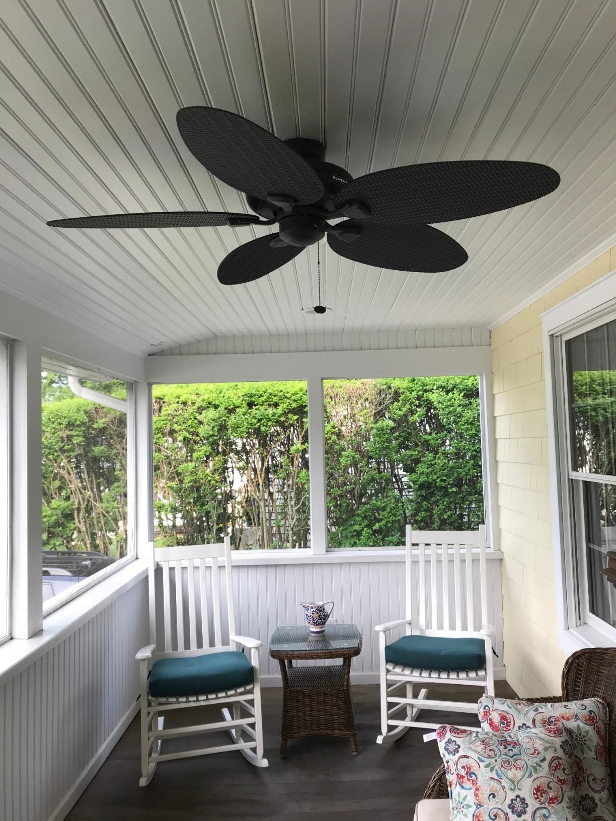 The black fan on a low-ceiling porch